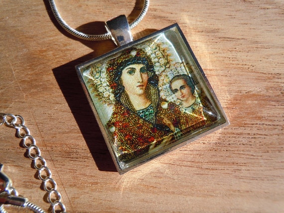 "Orthodox Icon pendant (1"") on shimmery paper with a matching silver plated snake chain (17"")"