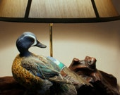 Duck Carving Lamp - Hand Carved Blue Winged Teal Table Lamp with a soft Moss-toned Shade on Mangrove Wood