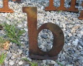 "Lowercase metal letter ""b"" on stand"