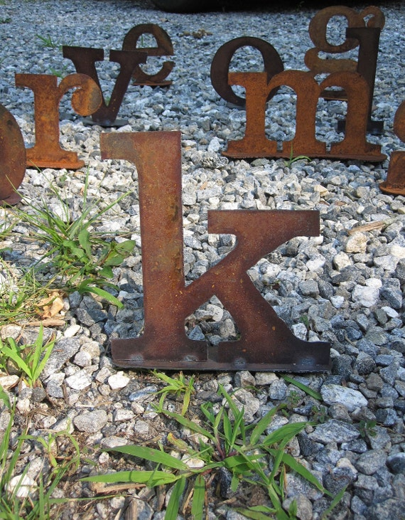 """Lowercase metal letter """"k"""" on stand"""