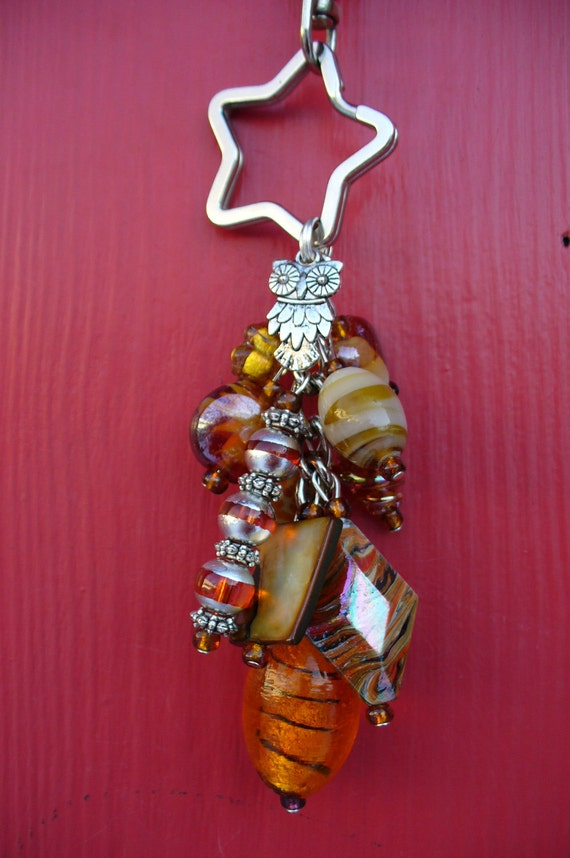 Amber and Beige Beaded Purse Charm.