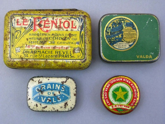 4 old tin containers  for collectors