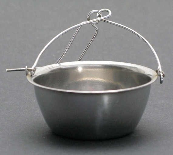 a french stainless  steel tea strainer
