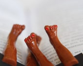 Bare man and woman feet in the book. Chocolate brown skin. Unusual art bookmark. Legs in the book. Funny gift for couple.