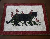 Beautiful hand appliqued black cat art quilt, Sassy in her Garden