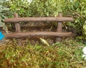 """miniature  fairy garden faux wood fence 3 """" wide 2 3/4"""" tall with wire stems for secure placement"""