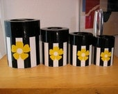 Set of graduated canisters with mod flower power graphics