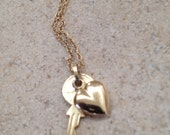 14 k gold  heart and key pendent hung from a  gold filled  necklace chain--EN2046