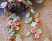 Bracelet: Peach, ceramic beads, green, cat eye beads, white, mother of pearl, gold chain, gold lobster closure