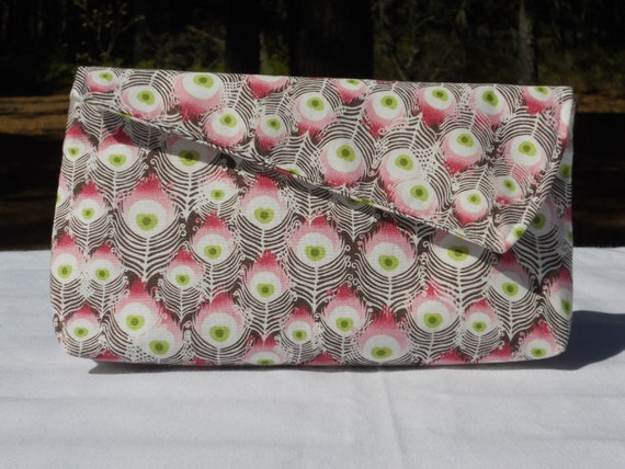 Pink, green, black feather print clutch