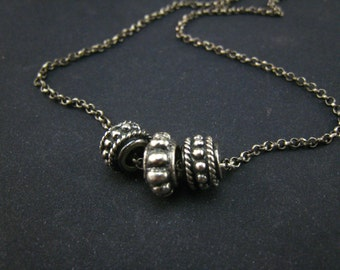 reserved-handmade bali style sterling silver small pendant