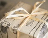 GIFT WRAPPING KIT -  5 sheets of black canoe kayak and paddle pattern on beige tissue with 10 yd beige raffia ribbon