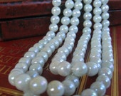 triple strand faux japanese pearl necklace blue/green tint