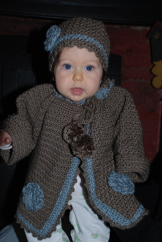 Hand crocheted baby sweater with matching hat