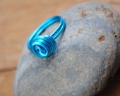 SALE Swirl infinity ring in electric blue wire wrapped any size