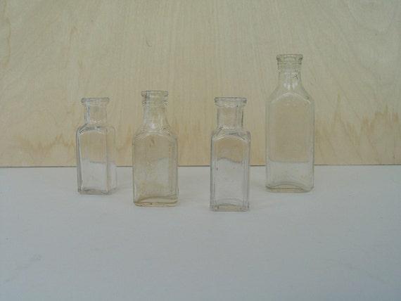 Lot of Four Vintage Clear Medicine Bottles