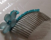 Sparkling silver hair comb decorated with blue crystals and blue lucite flower