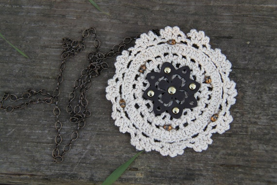 Bohemian-inspired brown and beige doily necklace.