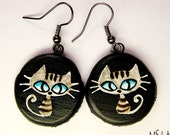 Black wooden earrings with blue eyed grey tabby cat
