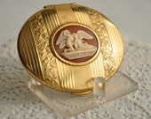 collectible vintage compact KGIU powder compact with romantic Greek cameo