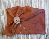 No. P18   Recycled rust color leather clutch