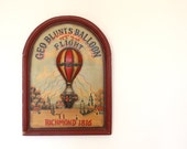 Vintage wooden tavern sign ballon flight burgundy