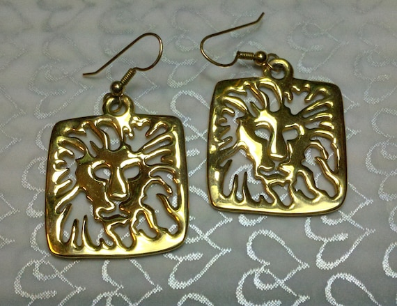 Anne Klein gold lion signature gold french wire earrings