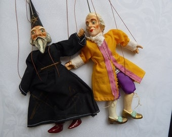 Two vintage pupets astrologe and men in medievel clothe czeck