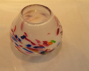 Hand blown glass vase of confetti hues on alabaster white