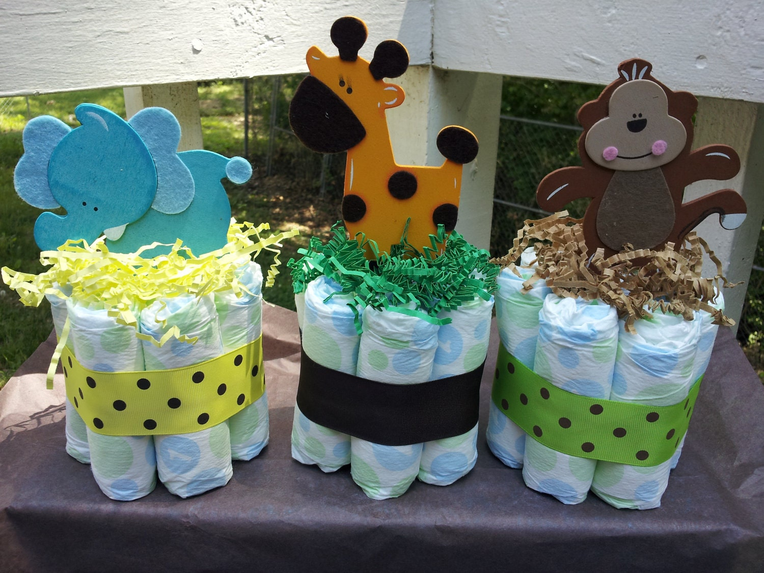3 jungle theme mini diaper cakes