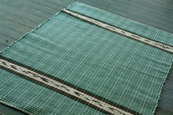 Handwoven rag rug in soft green.