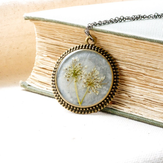 resin jewelry pressed flower necklace. queen annes lace circle filigree edge by studiobotanica