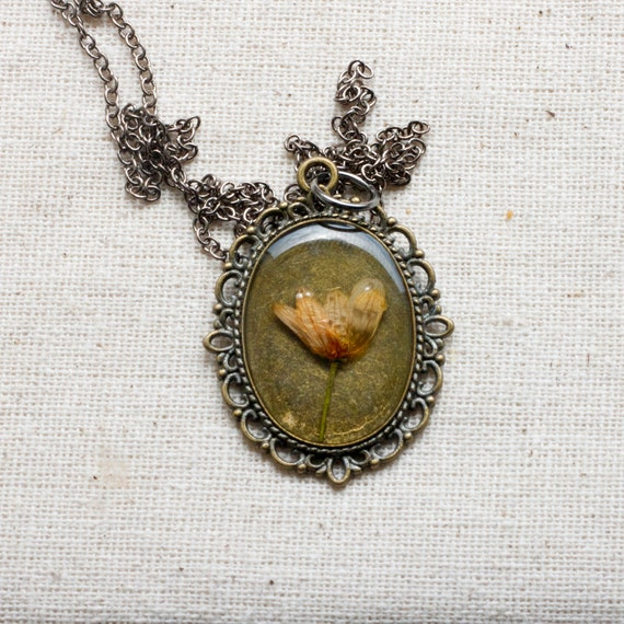 pressed flower necklace peach wildflower in bronze filigree setting resin jewelry shabby chic cottage farmhouse prairie