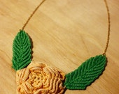 Necklace with found vintage yellow crochet flower and bright green leaves, gold-tone chain