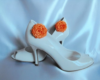 Handmade rose shoe clips in orange