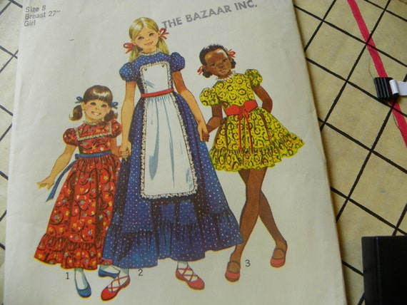 Simplicity pattern 9732 Girls dress w/ apron front  in two lengths size 8 1970's