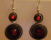 Black spiral and red rhinestone earrings