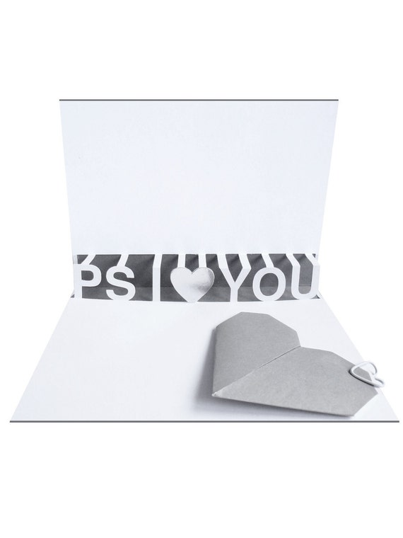 P.S. I Love You. Pop up card with 3D type and origami heart attached with heart-shaped paperclip. Grey, silver and white.