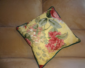 Pillow with red and green flowers and green piping