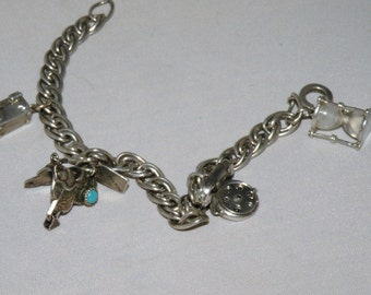 Vintage Charm Bracelet With Action Charms Telephone, Treasure Chest, Hour Glass and Western Saddle