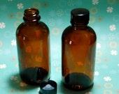 12 Amber glass bottles, 4-oz with black cap