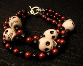 Day of the Dead Dia de los Muertos triple strand pearl skull bracelet jewelry charm cuff black red