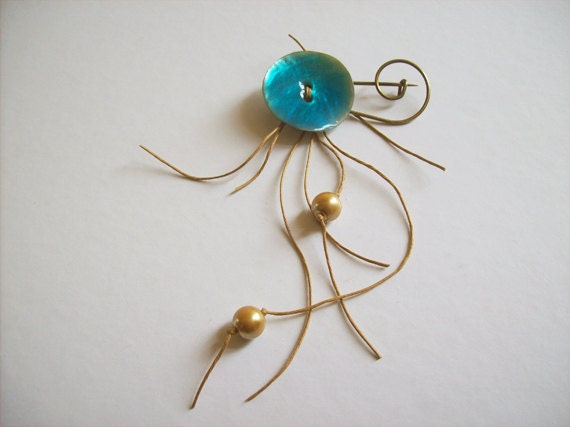 Turquoise blue shell button on bronze brooch with golden pearls