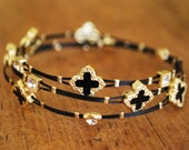 DELICATE  BRACELETS with  black cross,  also available in turquoise, very hip design