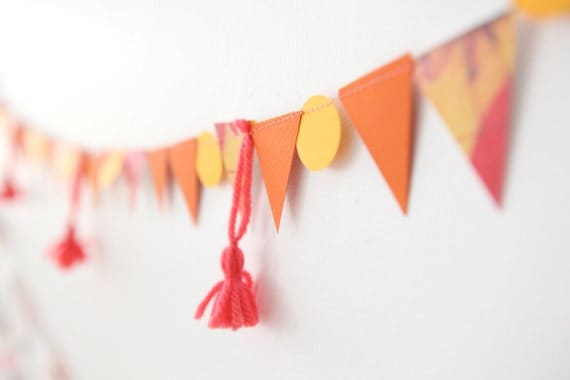 pretty in coral, pink, orange, yellow garland with tassels