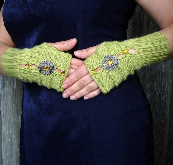 Light olive green  fingerless  gloves  with decorative elements.