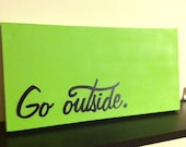 "Pastel green ""Go outside"" stencil art painting, spray painted on 10 x 20 inch gallery canvas"