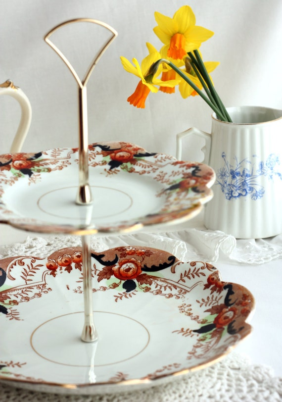 2 tier cake stand: upcycled brightly patterned vintage English china plates - a unique table centerpiece