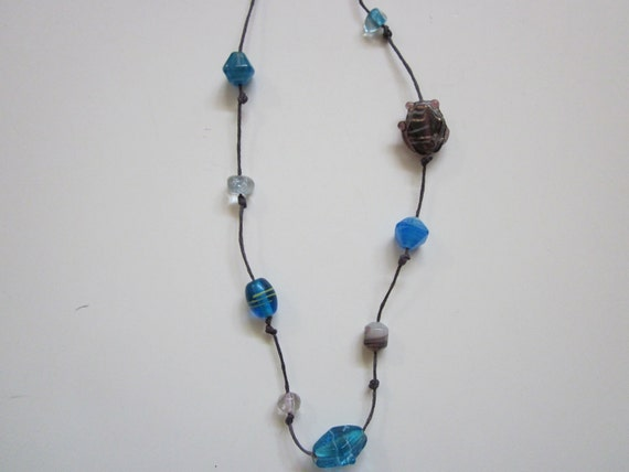 Discounted-Glass-Beaded Necklace on Purple Cord