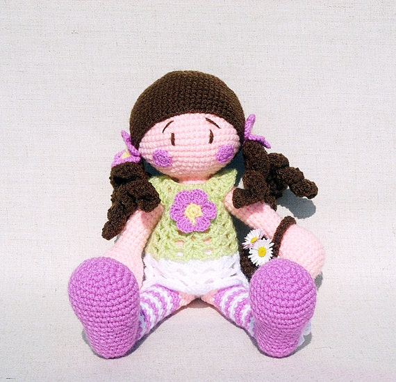 Crocheted doll with basket and flowers